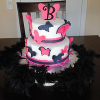 Butterfly Cake This is a white cake with buttercream filling and fondant. The butterflies are made from pink and black fondant. A feather boa around the...