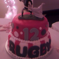 Rugby Groom's Cake The groom played rugby at Ohio State. Cake covered in fondant. I love the topper! TFL!
