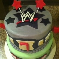 Wwe Vanilla Cake with Strawberry buttercream filling. Covered and Decorated with MMF. Enjoy!