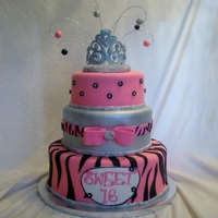 Sweet 16 Princess Cake 3 tier sweet 16 cake covered in fondant and accented with edible bling. Tiara is handmade and airbrushed silver.