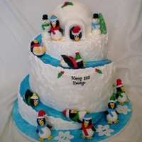 Winter Wonderland 3 tier cake...spiral slide is hand carved...cake is covered in fondant and buttercream. All accessories are handmade out of fondant and...