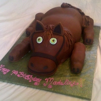 Carved Horse Cake Cake is carved out of full sheet cakes, arms and legs are made out of cupcakes.