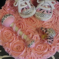 Baby Shower Cupcake Bouquets My first try at making these adorable shoes. Thanks to Cakes By Mayen for the tutorial on youtube. The cake was a huge hit and i am very...