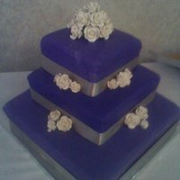 Purple And Silver Wedding Cake Purple velvet cake with Cream cheese icing, Homemade marshmallow fondant and gumpaste roses