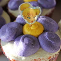 Tinkerbell Cupcakes Pink and purple french vanilla WASC with buttercream. Tinkerbell is a sticker on a toothpick