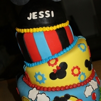 Mickey And Friends I did this fun topsy turvey cake for a first birthday. Mom wanted something grand and this is what I thought she would love. Cake is French...