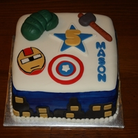 Avengers Cake  This is an avengers themed cake I did for a customer. Everything is MMF and the sides are hand painted blue with MMF buildings. Thanks for...