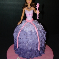 Ballgown Barbie Cake Vanilla cake with cookies-n-cream filling covered with vanilla fondant