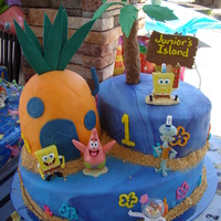 Sponge Bob This was for Junior's 1st birthday. Mom provided the characters and candle everything esle is ediable.