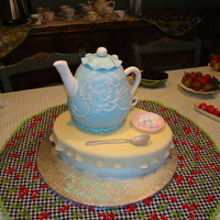 A Baby Is Brewing Every thing is edible. The table & teapot are cake, dish & spoon are gumpaste and additional details, handle, spout, sugar cubes,...