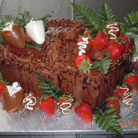 Chocolate Grooms Cake  This is a Chocolate cake, with chocolate fudge filling, with chocolate buttercream, and chocolate lava. Also Chocolate covered strawberries...