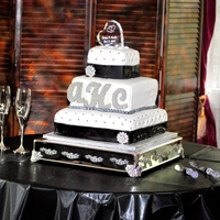 "Black & White Wedding Cake   This is a black and white wedding cake. 14',10"" & 6""."