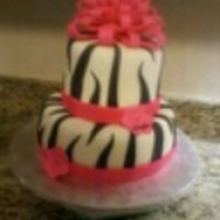 Zebra Birthday Cake White and chocolate cake layered to look like zebra stripes inside when cut. Covered in buttercream, then fondant. Fondant ribbon and bow...