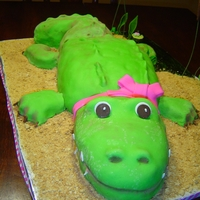 Alligator Cake Alligator with pink bow, chocolate cake w/MMF details. Made for a girl's birthday with alligator theme.