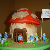 Smurf Cake MMF covered blue/white marbled cake. Decorations all MMF except for smurf figurines.