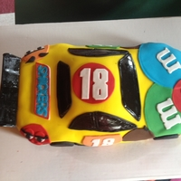 M&m Car Kyle Busch Chocolate cake covered in buttercream and fondant.My first car cake.