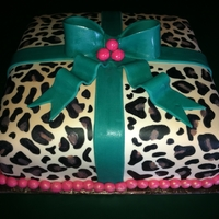 Leopard Present Cake Chocolate and strawberry cake with chocolate buttercream middle. Cake is covered in thin buttercream layer with ivory fondant. Leopard...