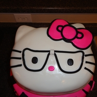 Nerdy Hello Kitty Chocolate Cake with Pink Fondant and Black Fondant Zebra Stripes. Fondant glasses for kitty.