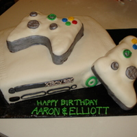 Xbox 360 Xbox 360 cake for two boys who had birthdays close together. Chocolate cake with oreo cookie filling. Two remotes were a little oversized-...