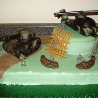 Army Theme Birthday Cake An army theme cake for a little boy turning 7 who loves anything army. The tank and helicopter are rkt covered with mmf.