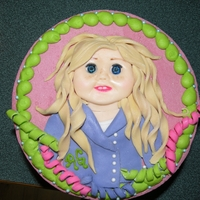 American Girl Cake   This cake is decorated in MMF and filled with Vanilla cake and Vanilla BC