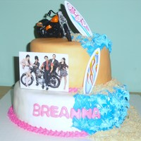 Teen Beach Movie Cake  Teen beach movie cake covered in marshmallow fondant , the pic was printed and laminated and the motorcycle and surf boards were store...
