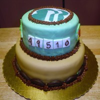 Girl Scout  Girl Scout two tier cake covered with fondant with thin mint cookies as part of border on bottom tier . Girl scout logo was printed and...