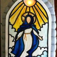 Assumption Of Mary Sun is lit by a small battery operated light.