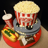 Movie-Themed Cake I made this for my boyfriend's birthday today! He loves movies so I added some of his favorite foods as well as a couple of movie...