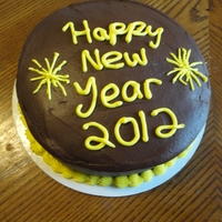 New Year This was a practice cake. It's a chocolate cake, peanut butter whipped frosting in the middle, and chocolate frosting. I know I need...