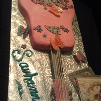 Taylor Swift Cake Guitar with flowers and butterflies