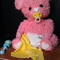 Baby Bear Rice krispie bear covered with vanilla frosting and fondant accents.