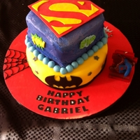 Justice League Birthday Cake  This cake was inspired by the many superhero cakes on Cake Central. It was my first stacked cake and the kids went nuts for it. The top...