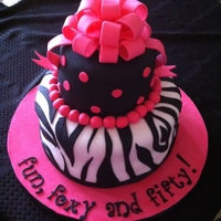 Fun, Foxy And Fifty   Two tier Red Velvet Cake with Cream Cheese Buttercream Icing covered in fondant.
