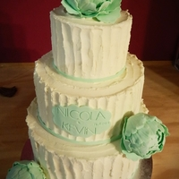 Green And White Wedding Cake  All red velvet cake with IMBC. The Bride requested white chocolate so I added about another 50% of white chocolate ganache. The flowers are...