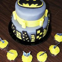 Batman Birthday Cake A 2 tier (8 inch and 6 inch) chocolate cake with chocolate butter cream filling covered in marshmallow fondant.