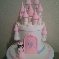 ~Princess Castle~   This is a princess castle cake I made for my nieces birthday. I made everything by nad and it is all edible. :)