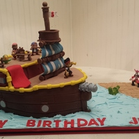 Jake And The Neverland Pirates!   This is a birthday cake I made for a little boy! The sails and mast took some time to make, but it made the cake! :)