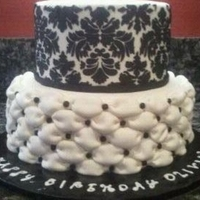 ~Sweet 16 Birthday Cake~ This is a two tiered Sweet 16 birthday cake! The customer wanted a black and white sophisticated birthday cake. The top tier is done in...