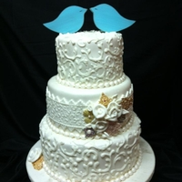 Shabby Chic Wedding Cake The bride loved her shabby chic wedding cake! The brooches are made of gumpaste using a mold from First Impressions. The birds on top are...