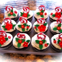 Christmas Cupcakes For A Friends 50Th Bd Found these curled candy canes at Michael's and thought they would make cute toppers on cupcakes.