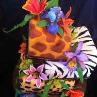 Safari Sweet 16 First time to make the Cattleya Orchid and Stargazer Lily. I love this cake!!