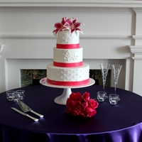 Fuschia And Purple Wedding My first wedding cake with a board less design! I think it turned out very nice :) TFL!