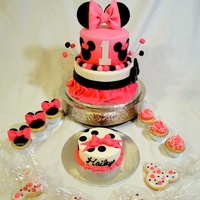 Mini Mouse 1St Birthday 2 tier, vanilla cake, BC, and covered in fondant. 10 vanilla cupcakes with chocolate BC died black, and mouse ears and bows, then 10 pink...