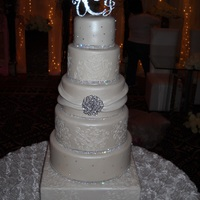 Ivory Wedding Cake All 6 tiers were airbrushed with pearl shimmer.