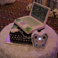 Apple Laptop Cake Very clever idea from the bride, the item on the side is suppose to represent a surveillance camera.