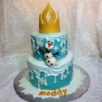 Frozen Cake Buttercream cake with Chocolate décor.white cake with hazelnut mousse filling.