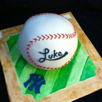 Baseball Cake My first time using the sports ball pan and also my first time hand painting a base! Thanks for the inspiration, i do believe my client got...