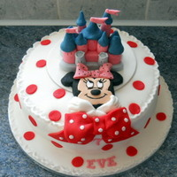 Mini Mouse   Made for a seven year old a similar castle to Disney on a plaque plus a mini mouse all made from fondant icing.