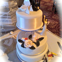 A Wedding At Albury Manor House  First use of a cake separator - used because the topper of the 'Reaching Bride' height 15 cms, required height of the third tier...